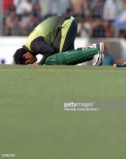 Pakistan cricketer Salman Butt touches the ground after scoring a century during the final One Day International Triseries match between Pakistan and...
