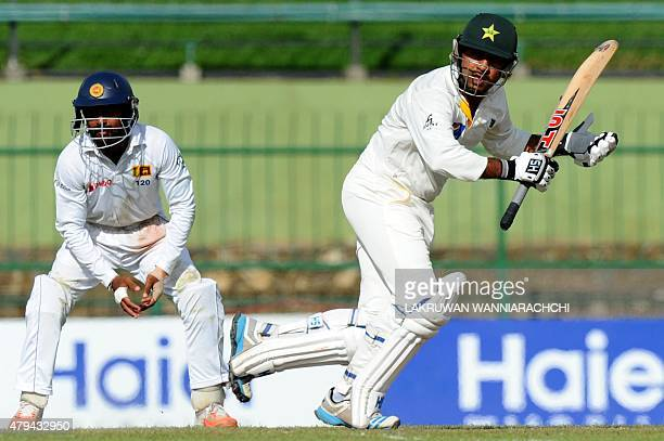 Pakistan cricketer Sarfraz Ahmed runs between the wickets as Sri Lankan cricketer Kaushal Silva look on during the second day of the third and final...
