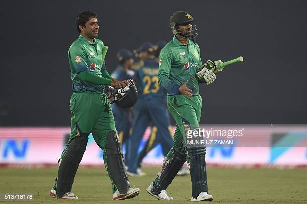 Pakistan cricketer Shoaib Malik and his teammate Iftikhar Ahmed walk off the field after winning the Asia Cup T20 cricket tournament match between...