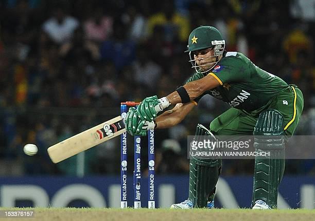 Pakistan cricketer Umar Akmal plays a shot during the ICC Twenty20 Cricket World Cup's semifinal match between Sri Lanka and Pakistan at the R...