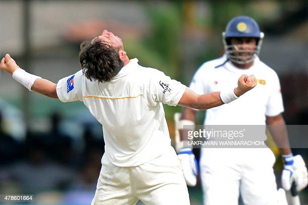 Pakistan cricketer Yasir Shah celebrates after dismissing Sri Lanka's captain Angelo Mathews during the second day of the second Test cricket match...