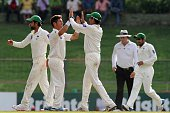 Pakistan cricketer Yasir Shah celebrates with his teammates after he dismissed Sri Lankan cricketer Jehan Mubarak during the third day of the third...