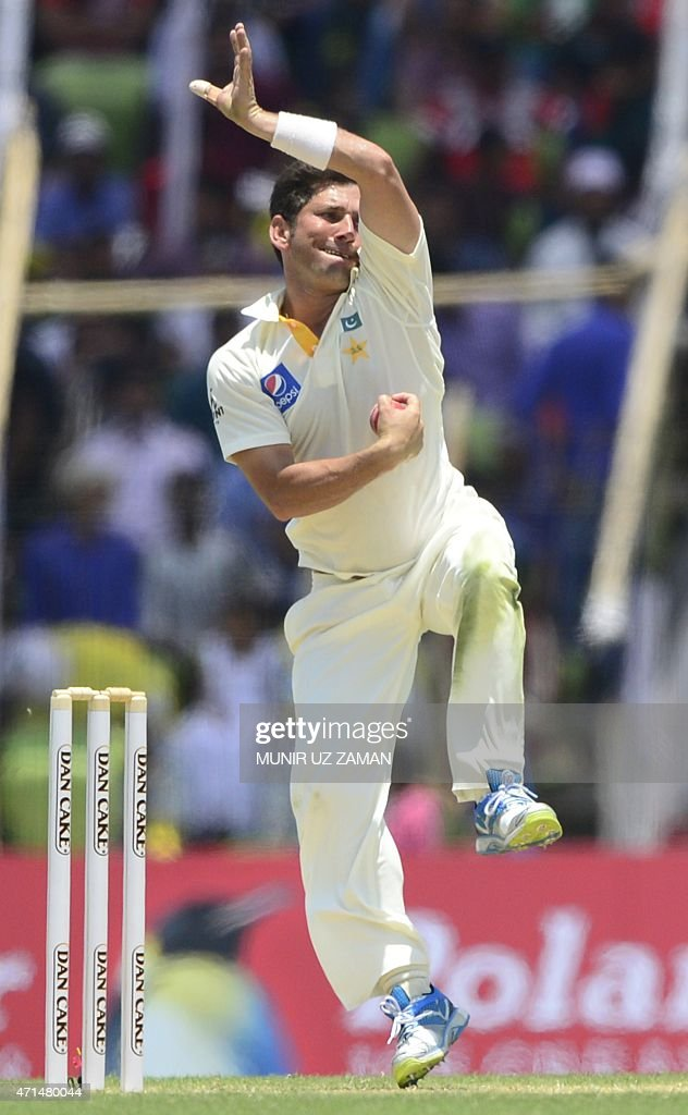 Pakistan cricketer Yasir Shah delivers a ball during the second day of the first cricket Test match between Bangladesh and Pakistan at The Sheikh Abu...