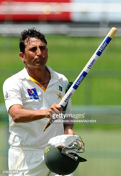 Pakistan cricketer Younis Khan waves a stump after his team's series victory following the third and final Test cricket match between Sri Lanka and...