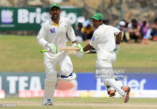 Pakistan cricketers Asad Shafiq and Sarfraz Ahmed run between wickets during the fourth day of the opening Test match between Sri Lanka and Pakistan...