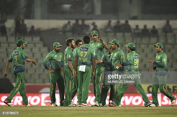 Pakistan cricketers celebrate after the dismissal of the Sri Lanka cricketer Dinesh Chandimal during the Asia Cup T20 cricket tournament match...