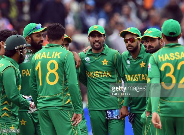 Pakistan cricketers celebrate the wicket of India's Shikhar Dhawan for 68 during the ICC Champions trophy match between India and Pakistan at...