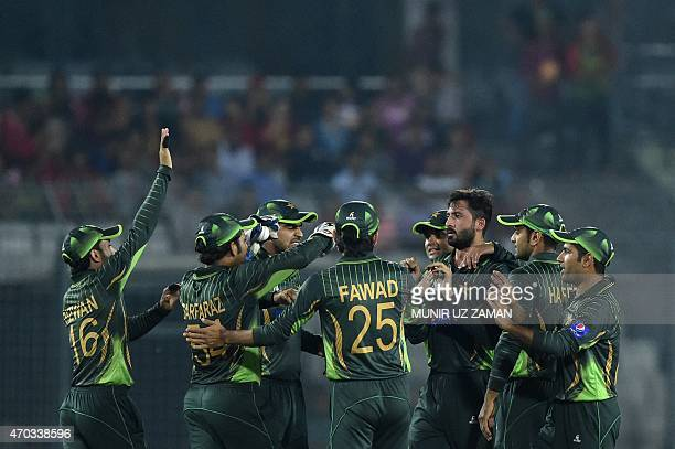 Pakistan cricketers congatulate teamate Junaid Khan after the dismissal of Bangladesh cricketer Soumya Sarkar during the second One Day International...