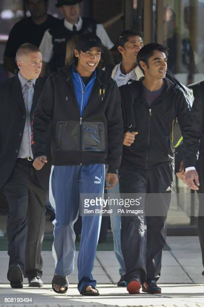 Pakistan cricketers Mohammad Amir and Captain Salman Butt leave the Holiday Inn in Taunton Somerset after the rest of the team go to train to head...