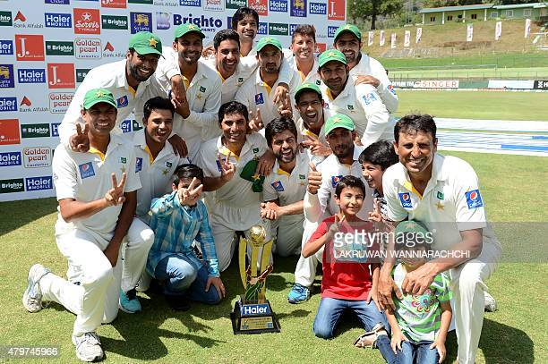 Pakistan cricketers pose after their team's series victory following the third and final Test cricket match between Sri Lanka and Pakistan at The...