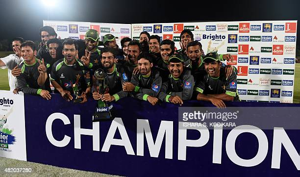 Pakistan cricketers pose after their team's series victory following the fifth and final one day international cricket match between Sri Lanka and...