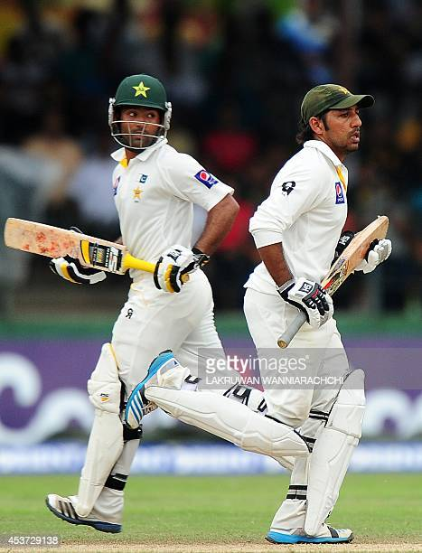 Pakistan cricketers Sarfraz Ahmed and Asad Shafiq run between the wickets during the fourth day of the second Test match between Sri Lanka and...