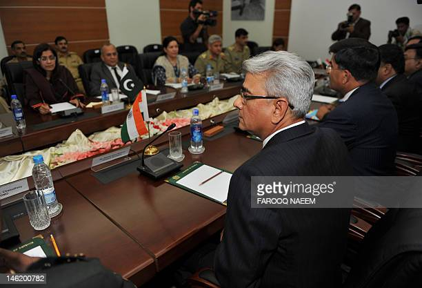 Pakistan Defence Secretary Nargis Seithi and her Indian counterpart Shashikant Sharma attend talks at the Defence Ministry in Rawalpindi on June 12...