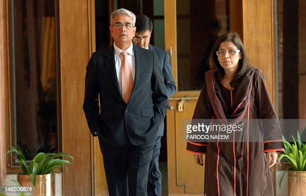 Pakistan Defence Secretary Nargis Seithi and her Indian counterpart Shashikant Sharma arrive for talks at the Defence Ministry in Rawalpindi on June...