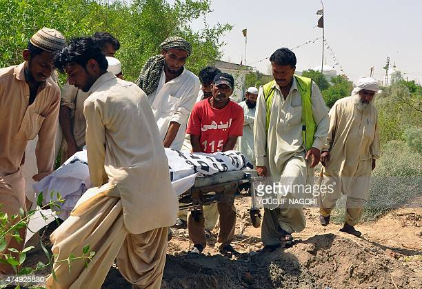 Pakistan Edhi volunteers carry the body of convicted hijacker Sabir Baluch through a graveyard ahead of his funeral in Hyderabad on May 28 2015...