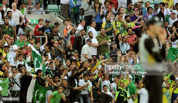 Pakistan fans celebrate as Pakistan's Shahid Afridi hits the winning runs during the ICC World Twenty20 Super Eights match at The Brit Oval London