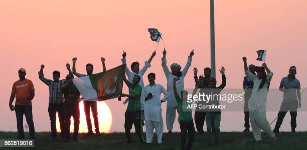 Pakistan fans celebrates during the third one day international match between Pakistan and Sri Lanka in Abu Dhabi at Zayed Cricket Stadium on October...