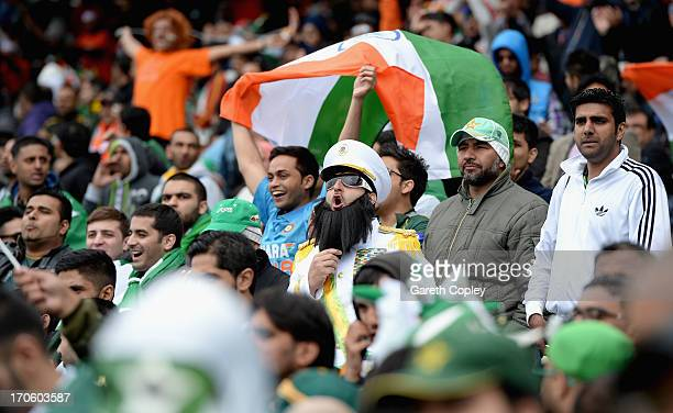 Pakistan fans cheer during the ICC Champions Trophy match between India and Pakiatan at Edgbaston on June 15 2013 in Birmingham England