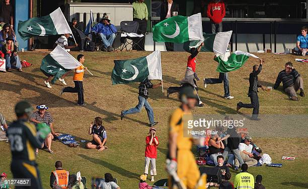Pakistan fans run with flags during the ICC Champions Trophy Group A match between Australia and Pakistan played at Supersport Park on September 30...