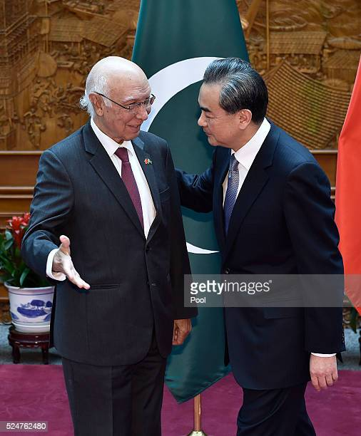 Pakistan Foreign Affairs Adviser Sartaj Aziz is welcomed by Chinese Foreign Minister Wang Yi before a meeting at the Ministry of Foreign Affairs...