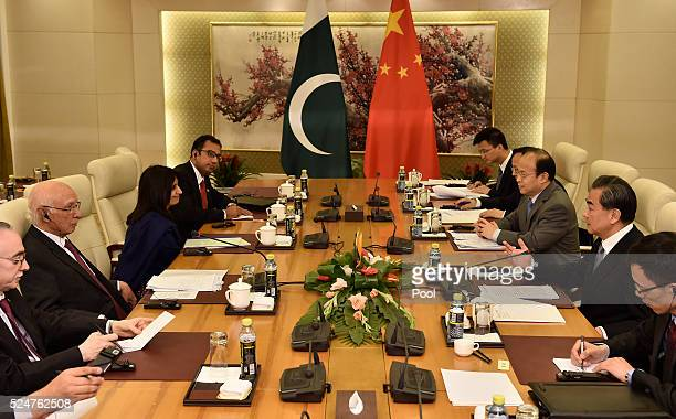 Pakistan Foreign Affairs Adviser Sartaj Aziz talks with Chinese Foreign Minister Wang Yi during a meeting at the Ministry of Foreign Affairs April 27...
