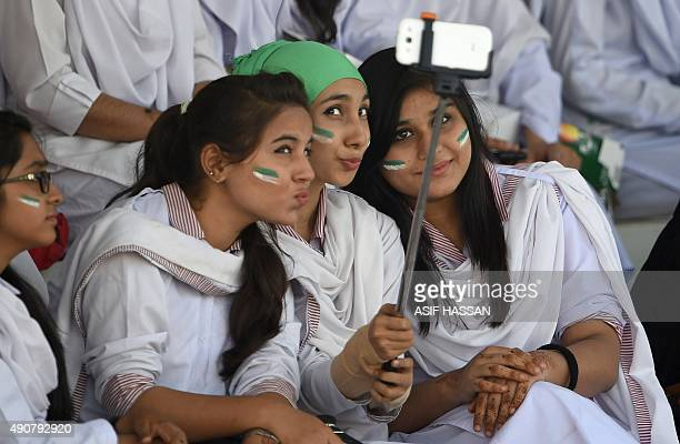 Pakistan girls use a selfie stick to take a photograph woth their mobile phone during the second T20 match between the Pakistan and Bangladesh...