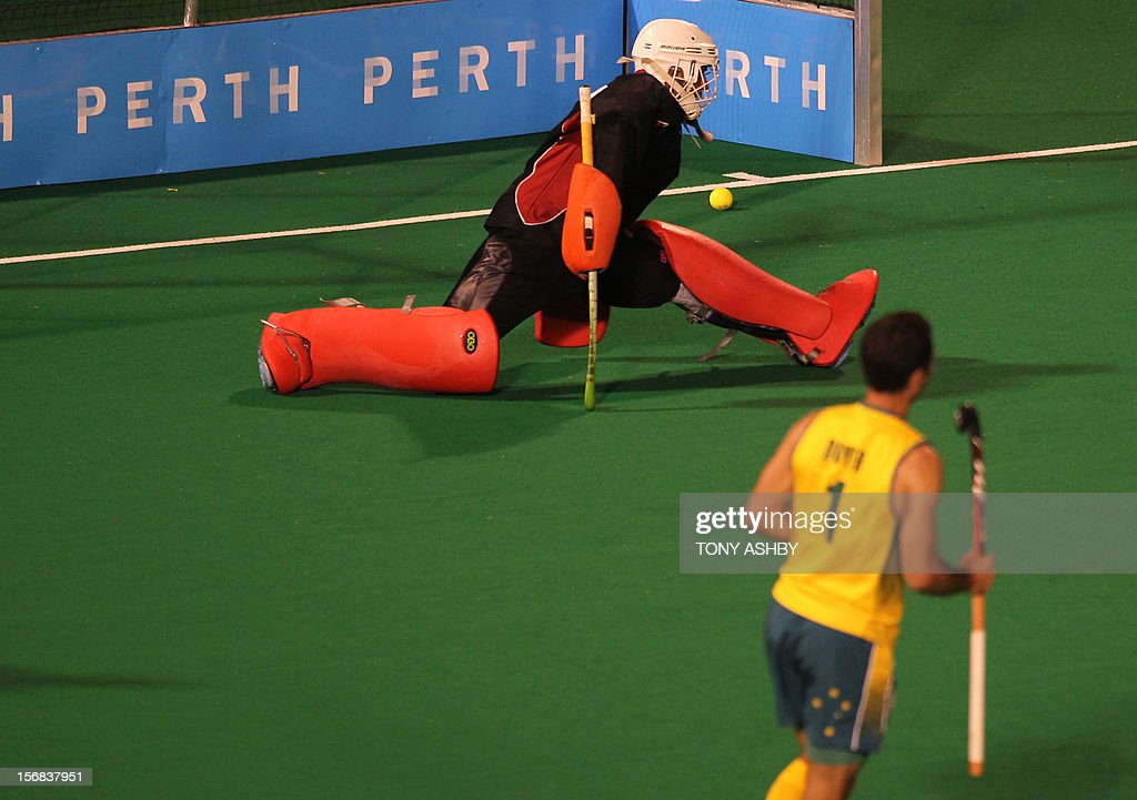 Pakistan goalkeeper Imran Shah (top) misses the shot from Jamie Dwyer of Australia (R) as he scores one of his two goals during their mens match at the International Super Series hockey tournament in Perth on November 22, 2012. AFP PHOTO/Tony ASHBY RESTRICTED