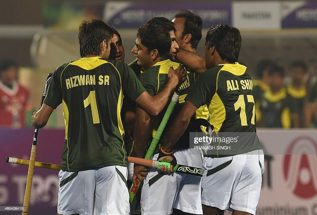 Pakistan hockey players celebrate a goal against India during their Hero Hockey Champions Trophy 2014 semi final match at Kalinga Stadium in...