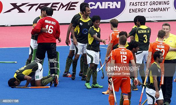Pakistan hockey team players celebrate after their win against Netherlands during the quaterfinal match of Hero Champions Trophy 2014 at Kalinga...