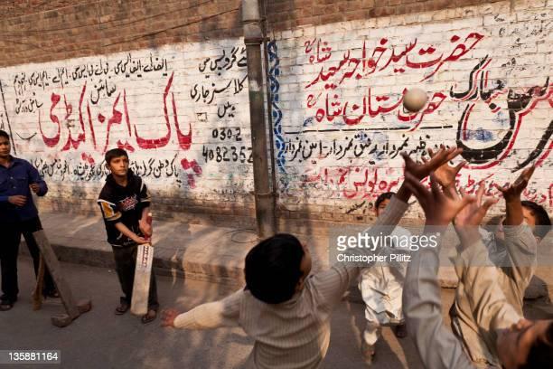 Pakistan - Kids playing cricket on city streets