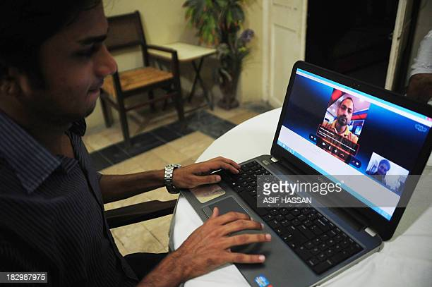 A Pakistan man chats with his friend on an online network in the port city of Karachi on October 3 2013 Pakistan's southern Sindh province will block...