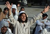 Pakistan members of Jamiat Nazriati party shout slogans in a rally to pay tribute to Afghanistan's deceased Taliban chief Mullah Omar in Quetta on...