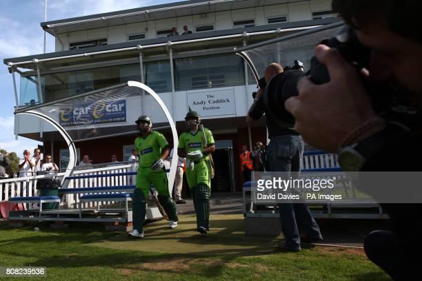 Pakistan openers Shahzaib Hasan and Mohammad Hafeez take the field to bat under the media spotlight