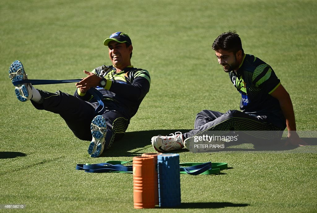 Pakistan opening batsman, <a gi-track='captionPersonalityLinkClicked' href=/galleries/search?phrase=Ahmed+Shehzad&family=editorial&specificpeople=5893396 ng-click='$event.stopPropagation()'>Ahmed Shehzad</a> (R) and <a gi-track='captionPersonalityLinkClicked' href=/galleries/search?phrase=Nasir+Jamshed&family=editorial&specificpeople=4819500 ng-click='$event.stopPropagation()'>Nasir Jamshed</a> (L) do stretching exercises during training ahead of their next 2015 Cricket World Cup Pool B match against Ireland at the Adelaide Oval on March 14, 2015. AFP PHOTO/Peter PARKS --IMAGE
