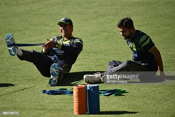 Pakistan opening batsman Ahmed Shehzad and Nasir Jamshed do stretching exercises during training ahead of their next 2015 Cricket World Cup Pool B...