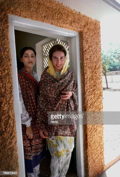 Pakistan People's Party candidate Benazir Bhutto poses with her personal assistant at her family home after returning from exile to launch her...
