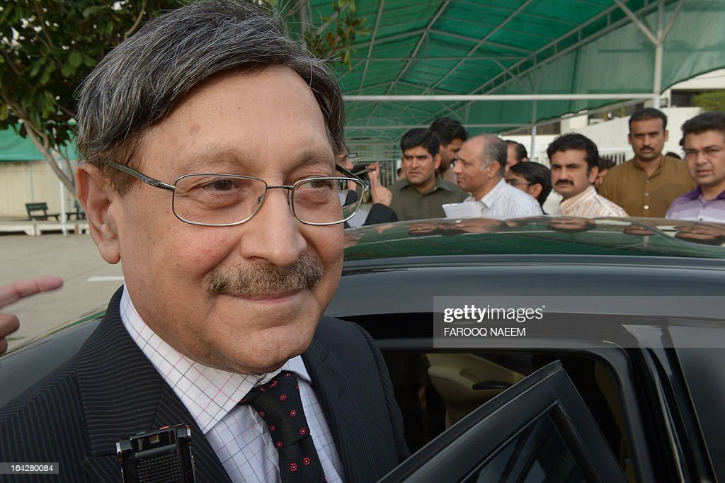 Pakistan Peoples Party (PPP) leader and former law minister Farooq H. Naik leaves after a meeting to discuss the caretaker prime minister outside the parliament house in Islamabad on March 22, 2013. Pakistan will go to the polls on May 11, the presidency announced March 20, in an historic general election marking the first democratic transition of power in the country's 66-year existence. AFP PHOTO/ Farooq NAEEM