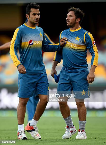 Pakistan player Mohammad Nawaz calms spinner Yasir Shah after an exchange of words with Wahab Riaz during a football game in the team's training...