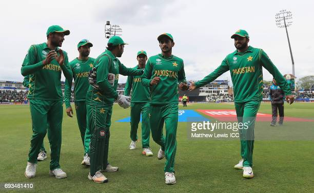 Pakistan players appalud Hasan Ali of Pakistan after the first innings during the ICC Champions Trophy match between Pakistan and South Africa at...