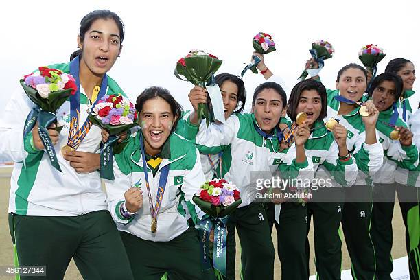 Pakistan players celebrate after defeating Bangladesh to win the gold in the cricket women's final on day seven of the 2014 Asian Games match at...