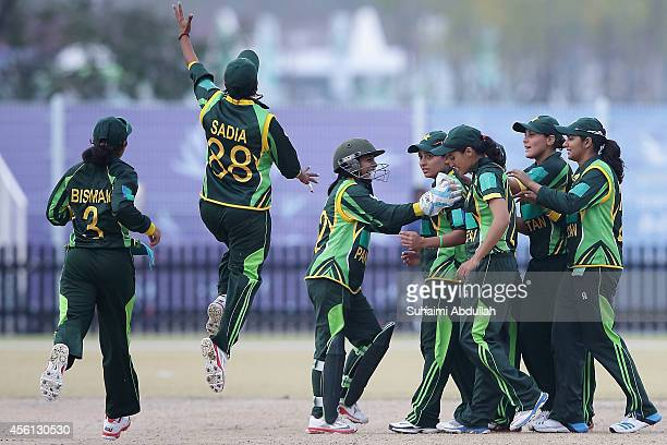 Pakistan players celebrate after dismissing Fahima Khatun of Bangladesh during the cricket women's final match between Pakistan and Bangladesh on day...