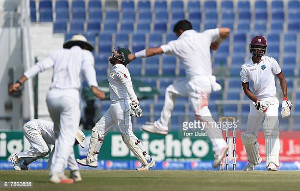 Pakistan players celebrate taking the wicket of Roston Chase of West Indies during Day Five of the Second Test between Pakistan and West Indies at...