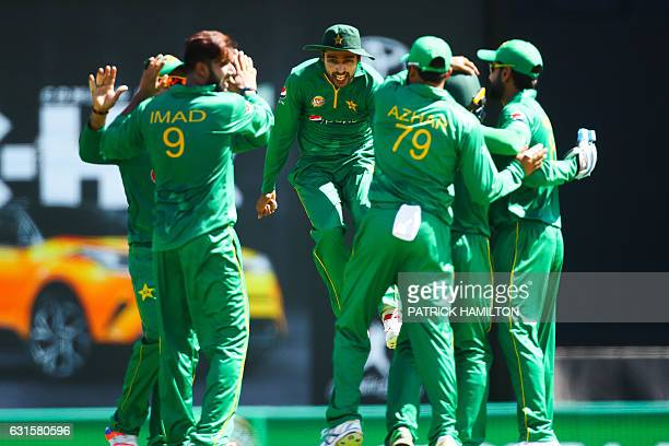 Pakistan players celebrate the wicket of Australian batsman Mitchell Marsh during the oneday international cricket match between Pakistan and...