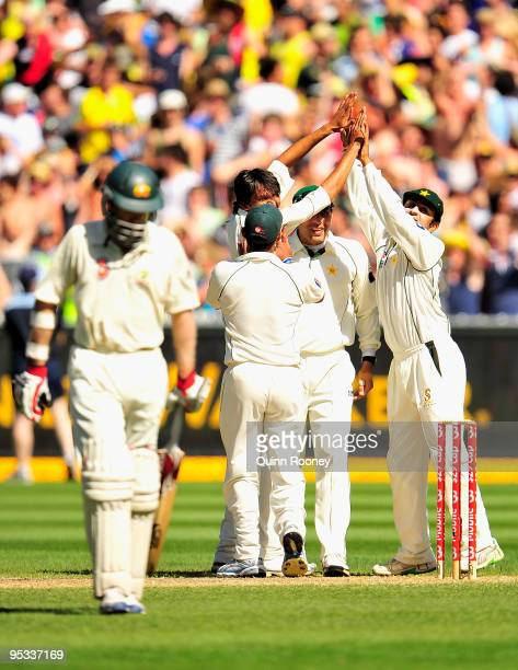 Pakistan players celebrate the wicket of Simon Katich of Australia during day one of the First Test match between Australia and Pakistan at Melbourne...