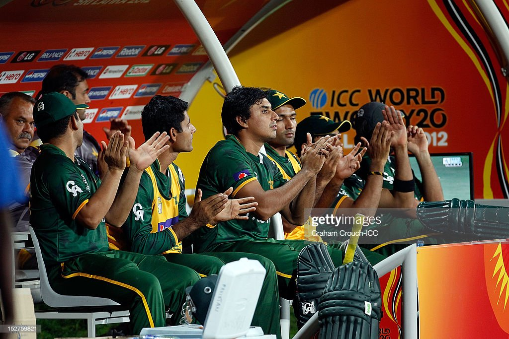 Pakistan players in the boundary line dug out during the Group D match between Pakistan and Bangladesh at Pallekele Cricket Stadium on September 25, 2012 in Kandy, Sri Lanka.