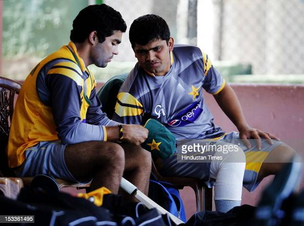 Pakistan Players Kamran Akmal and Umar Akmal during a practice session at P Sara Oval Cricket Ground on October 3 2012 in Colombo Sri Lanka