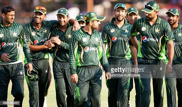 Pakistan players leave the field after winning the first of two T20 cricket matches between Pakistan and hosts Zimbabwe at the Harare Sports Club on...