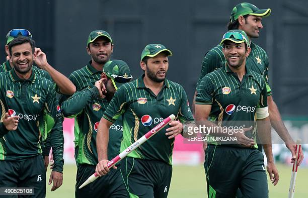 Pakistan players leave the pitch lead by captain Shahid Afridi after a series victory during the second of two T20 cricket matches between Pakistan...