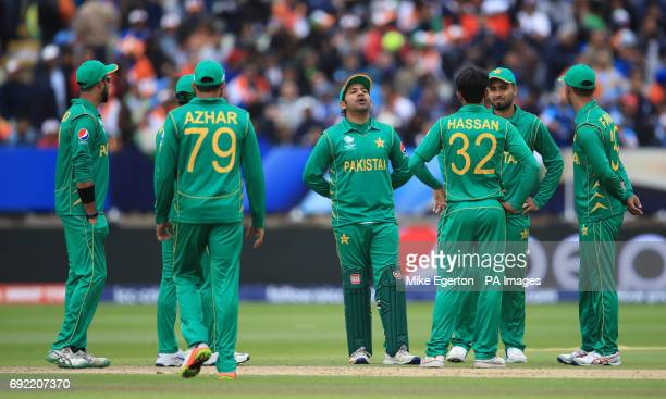 Pakistan players stand dejected during the ICC Champions Trophy Group B match at Edgbaston Birmingham