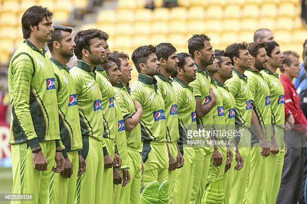 Pakistan players stand for their national anthem during the first oneday international cricket match between New Zealand and Pakistan at Westpac...